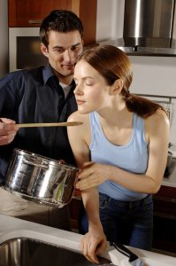 Husband and Wife Preparing a Meal