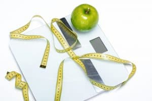 Apple, Scale, and Tape Measure