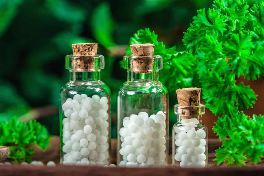 Homeopathic globules in small bottles.